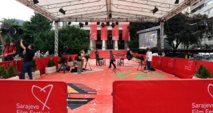 epa08603527 Bosnian television workers on the red carpet are preparing to broadcast the opening of the 26th Sarajevo Film Festival, in Sarajevo, Bosnia and Herzegovina, 14 August 2020. The red carpet was rolled out symboically as no guests will attend the opening event. The festival, that runs from 14 to 21 August 2020 and in which a total of 49 movies will be shown in the competition for the 'Heart of Sarajevo' awards, will be held entirely in an online format because of the alarming coronavirus pandemic situation in the Sarajevo Canton  EPA-EFE/FEHIM DEMIR