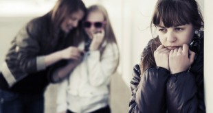 Teenage girls in conflict on the city street